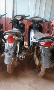 Two of the seized motorbikes, now very damaged.